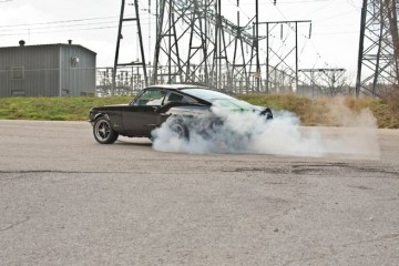 electric-1968-ford-mustang-fastback-rear-view-of-burnout