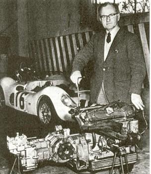 Ilario Bandini, standing next to a Bialbero engine.